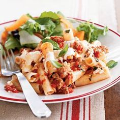 This easy, cheesy pasta recipe features ziti, turkey sausage, canned tomatoes, and fresh basil. It's a perfect pasta dish for busy weeknights.