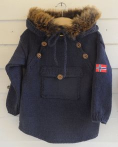 Warm and comfy jacket made in DROPS Lima. The edge is made by fake fur and sewn on. The pattern is for sale at www. And is available in English and Norwegian for kids and in Norwegian for adults. Knitting For Kids, Knitting Projects, Big Knit Blanket, Jumbo Yarn, Big Knits, Knit Pillow, Baby Kind, Stockinette, Wardrobe Capsule