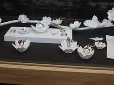 white paper flower jewellery display