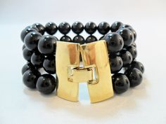 Vintage Bracelet / Bangle / Cuff Signed MONET Black Lucite Chunky Beads Gold Tone Metal MOD Large Retro Art Deco 1980's by KathiJanes on Etsy