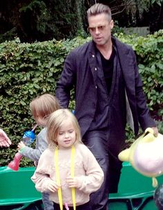 Brad Pitt spends time with his twins Vivienne and Knox at Legoland in the U.K. Click to read more