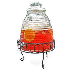 Sweet as honey, this delightful drink dispenser is guaranteed to eliminate those sticky (beverage) serving situations! With a 2.25-gallon capacity, hand-blown ribbed glass design, wrought iron stand...