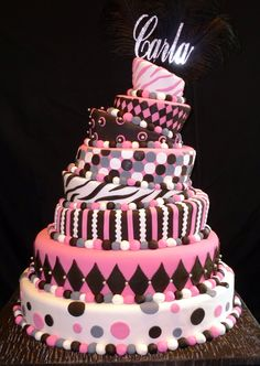 This topsy-turvy, black and pink cake made the perfect 15th Birthday cake! Check out more of our cakes at www.mediterraneanvilla.net