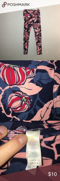LulaRoe Leggings Navy blue background with a soft pinkish leaf pattern and red flower buds. A little bit of pilling in inner thigh area and waistband is a little stretched out as seen in the pictures. Fits like a regular one size. LuLaRoe Pants Leggings