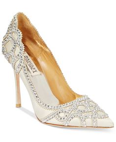 Sparkling glass details and a classic pointed toe give the Rouge pumps by Badgley Mischka a timeless look that dazzles. | Imported | Satin upper | Pointed closed-toe pumps | Allover glass embellishmen