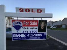 Real estate sold sign Sarah Justason