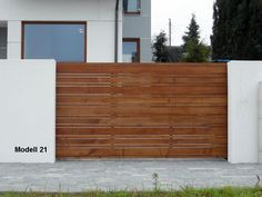 Schiebetor. Holztore . Das Tor ist auf die Stahlkonstruktion gebaut. | eBay