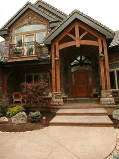 I like the stone and thick wood.  Not as much a fan of the multi-tiered roof line.  Looks pompous @ Pin For Your Home