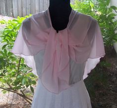 Pale Pink Chiffon Scarf Capelet or Shawl or by YAHAccessories This versatile scarf, shawl, capelet, is a lovely thing to wear over a hospital gown, Only $26.00 from Yahaccesories on Etsy.com. You can find it at:/www.etsy.com/listing/154280594/pale-pink-chiffon-scarf-capelet-or-shawl?ref=br_feed_52&br_feed_tlp=holidays It would look great worn over this SilverMoonBay.com hospital gown:http://www.silvermoonbay.com/Pink_Lotus_double_snap_sleeves_p/1052839.htm Only $37.99.