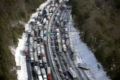 Winter Weather, In this aerial photo, traffic is snarled along the I-285 perimeter north of the metro area after a winter snow storm, Wednesday, Jan. 29, 2014, in Atlanta. (AP Photo/David Tulis)