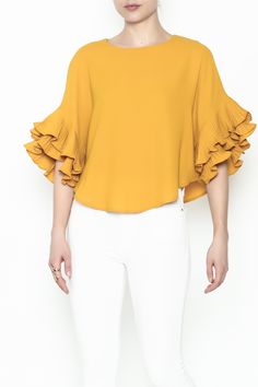 Boxy ruffle shoulder solid color blouse.   Ruffle Boxy Blouse by Ina. Clothing - Tops - Blouses & Shirts New York City Manhattan, New York City