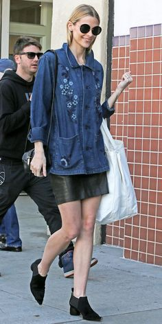 Jaime King in a denim printed top + leather skirt  + ankle boots for a cool daytime look