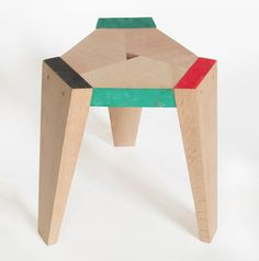 "end table ""made of leftover timber with painted ends"""