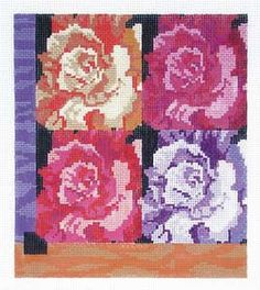 Rose Small  by Ruth Schmuff Designs      1055 - 18ct    Four beautiful roses in shades of raspberry and orange. When stitched simply insert in a Lee leather purse for a fashionable new accessory. (leather accessory sold separately) 5.5 x 6.5 on 18ct mono.