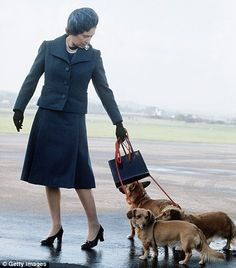 Her best friends: Queen Elizabeth ll arrives at Aberdeen Airport with her corgis to start her holidays in Balmoral, Scotland in 1974