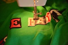 "Recycle letters from old t-shirts to applique words/names onto new shirt for a ""Ransom Note"" look"