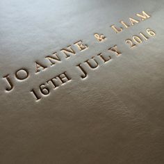 gold lettering on an ivory shimmer leather wedding album