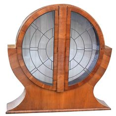 1930s English Art Deco Circular Display Cabinet in Walnut | From a unique collection of antique and modern cabinets at https://www.1stdibs.com/furniture/storage-case-pieces/cabinets/