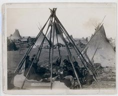 Home of Mrs. American Horse. Visiting squaws at Mrs. As home in hostile camp Oglala women and children seated inside an uncovered tipi frame in an encampment--most are looking away from the camera--probably on or near Pine Ridge Reservation. 1891. Repository: Library of Congress Prints and Photographs Division Washington, D.C. 20540 #