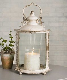 Shabby Chic Ivory Oval Lantern W x x Top opens with a latch. Candles are not included. Hanging Candle Lanterns, Candles And Candleholders, Lantern Candle Holders, Lanterns Decor, Candle Sconces, Shabby Chic Bedrooms, Shabby Chic Cottage, Shabby Chic Candle, Vintage Candles