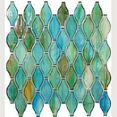 """All I can say is WOW!  These beautiful Clear Turquoise Unique Shapes (Green 1 3/8"""" x 3"""" Glossy Glass) Tiles are fabulous and remind me of the colors of the sea.... a MUST HAVE in a beach house kitchen, bathroom or floor!!"""