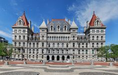 New York State Capitol Building is said to be haunted by a night watchman who died in a 1911 blaze when thousands of books burned but sacred Iroquois artifacts were spared. Haunted Tours are offered and include tales of employees who often describe flickering lights and mysterious cold spots.