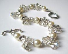 Silver Cluster Bracelet with ivory swarovski pearls, crystal silver Swarovski crystals, and sterling silver. By OpheliasJewels, $60.00