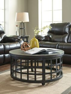 Marimon - Black - Round Cocktail Table by Signature Design by Ashley. Get your Marimon - Black - Round Cocktail Table at Furniture Warehouse, Holland MI furniture store. Round Black Coffee Table, Leather Coffee Table, Coffee Table Images, Cool Coffee Tables, Coffee Table With Storage, Design Living Room, My Living Room, Ashley Furniture Industries, Home Furniture