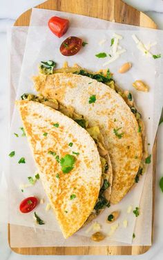 Healthy Make Ahead Breakfast Quesadilla. Easy, freezer friendly, and delicious! Vegetarian recipe with scrambled eggs, cheese, and spinach. Recipe at wellplated.com   @wellplated