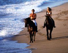 Horseback riding on the beach in Hawaii...