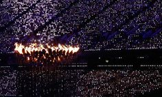 The Olympic flame burns for a few minutes more, before being extinguished during the Closing Ceremony of the London 2012 Olympic Games, on August 12, 2012. (Reuters/Pascal Lauener)