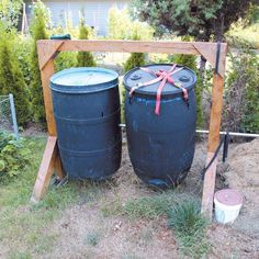 Double your compost with a DIY compost tumbler with two barrels at work.data-pin-do=