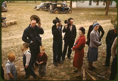 Saying grace before the barbeque dinner at the New Mexico Fair. Pie Town, New Mexico, October 1940.