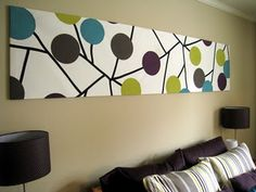 DIY artwork: would be easy to paint for over the couch and pick any colors that matched!