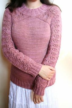 This cosy sweater will keep you warm and happy during cold days. Original top down seamless construction makes it a fun and quick knit. Easy to memorize lace pattern creates a romantic and feminine look.