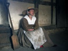 For example: light partlet (the white thing). Tudor Cookery Workshop | Haddon Hall. Note also her straw hat.
