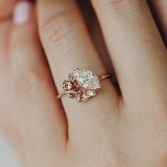 The Blushing Ring. A remarkable 1.03ct. marquise cut champagne diamond forms a clustered circle with blush toned gemstones for a stunning one of a kind creation set in 14k rose gold. Unlike any other just like the love between you. May you always make each other blush.