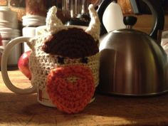 At first I thought this was a cow. :( Crocheted Viking Coffee Mug Cozy by LegendaryCrafts on Etsy