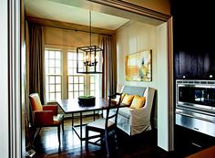 + ENLARGE Atlanta designer Robert Brown created this sunny breakfast room, which is furnished with a settee from Lee Industries, a Robert Allen leather armchair, and a wood-topped Henredon table that's suited for dining or paperwork.  Interior Design: Robert Brown Kitchen Design: Lina Pittam Architect: Lew Oliver  Tags: Design Ideas, Kitchen Design Po