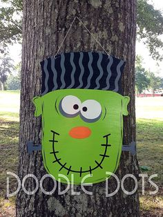 Frankenstein Door Hanger by DoOdLeDotsAnDmOre on Etsy, $30.00