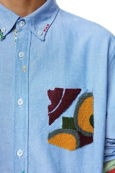 Desigual Men's blue long-sleeved shirt with a colorfully embroidered pocket and contrasting details. Check our Men's collection!