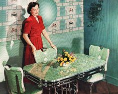 1950's. I really want that dining set!  My grandmother had a red one and my mother had a yellow one, but, alas, I have none!