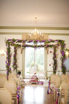 LOVE this Beautiful Green Garland Mandap- Love the greenery, change the purple to white/blush, the only thing I would add is a chandelier dangling from the top. Like the white furniture.