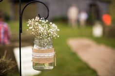 Rustic wedding ceremony aisle marker idea - baby's breath in mason jars wrapped with burlap + lace {Jasmine Rose Photography}