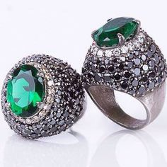 A beautiful ring in silver , studded with Emerald, black and champagne diamonds!  Just awesome one!