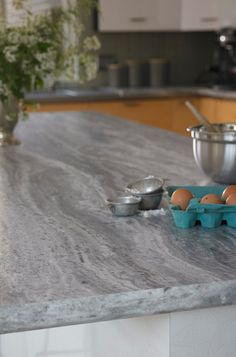 180fx® by Formica Group - 9302-34 Fantasy Marble is inspired by Fantasy Brown marble from India, a flowing stream of pewter, sand and earth tones.  180fx® is a budget smart decision for stylish, kitchen islands and counters. Getting a real slab of a stone in this pattern will cost $75 sq ft before installation.