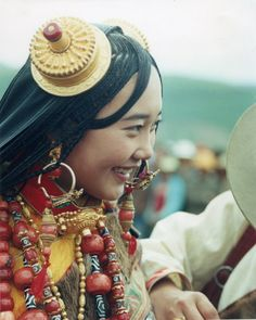 Litang Horse Race Festival pre-2009 | Note that this is the same girl as in the previous photo but on a previous year, she is wearing some different jewelry. She is a Local girl at the Litang Horse Festival dressed to the nines in her family's life savings. Image credit: 李行德