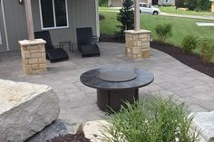 This Lafitt Rustic Slab patio is primed and ready for some after hours relaxation.   #topekalandscape #topeka #landscape #outdoorimagination #paver #patio