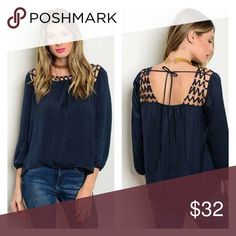 """🎀New Arrival 🎀 Navy Satin Tie Top This listing is for a Navy Satin Tie Top.    Cut out metal detail around neckline, tie in back.  *fabrics - 100% polyester, hand wash cold & line dry *measurements - small*armpit-to-armpit 18"""" length 22"""" medium*armpit-to-armpit 19"""" length 22 1/2"""" large*armpit-to-armpit 19 1/2"""" length 23 1/2""""  *top will be delivered gently steamed & beautifully wrapped in tissue. Tops Blouses"""