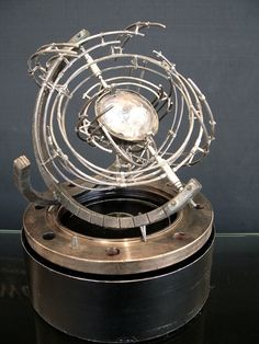 Device with Unknown Purpose - Astrolabe, orrery, gyroscope...  many of us have heard the words.  Can you work them, or explain them?  This device, this does something different.  I knew what it was, just a moment ago, hold on...